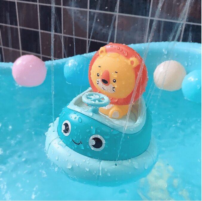 Đồ chơi nhà tắm phi thuyền xoay tự động biết phun nước